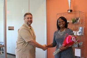 San Diego Christian College APS Honors Speaker chosen flowers handshake