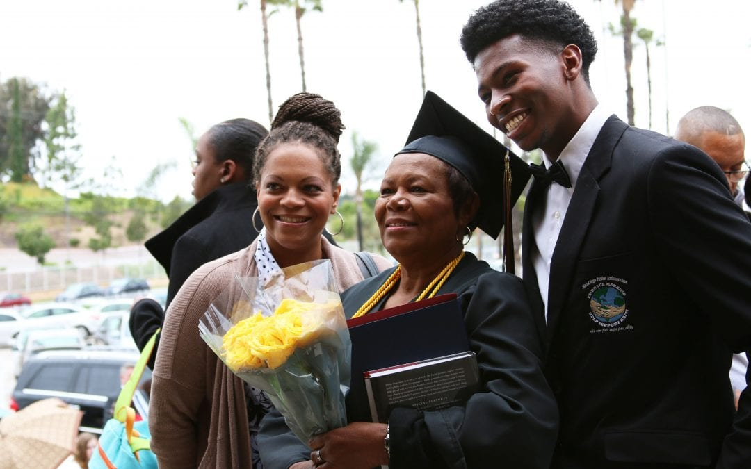 San Diego Christian College graduates pose with proud family members