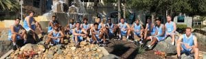 San Diego Christian College mens basketball team pose in front of the SDCC fountain
