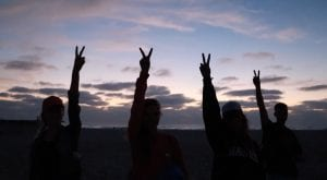 San Diego Christian College Students giving the peace sign