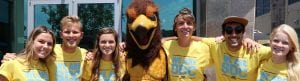 San Diego Christian College students pose with Hawk mascot