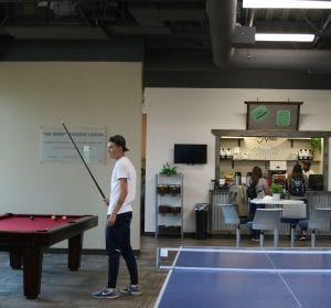 San Diego Christian College campus amenities, student playing pool
