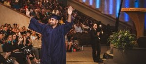 San Diego Christian College graduate takes the stage to generous applause