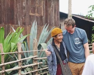 Global Missions, volunteer hugging elderly woman